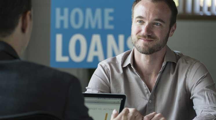 Man talking to financial advisor