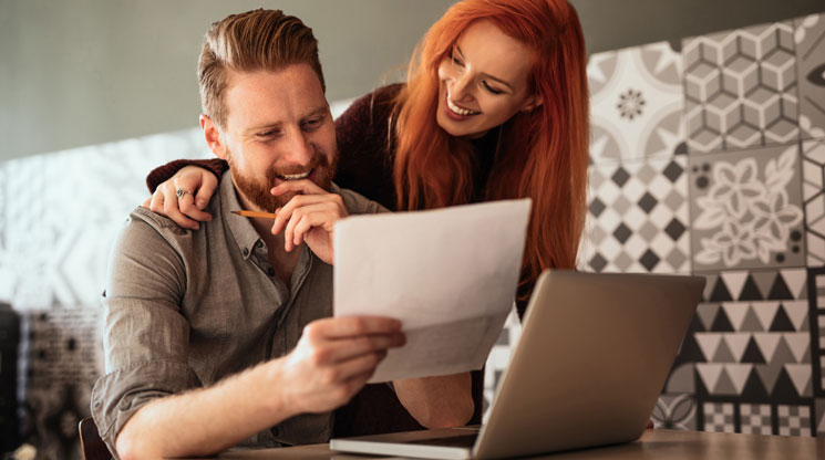 Wife and Husband looking at financial documents