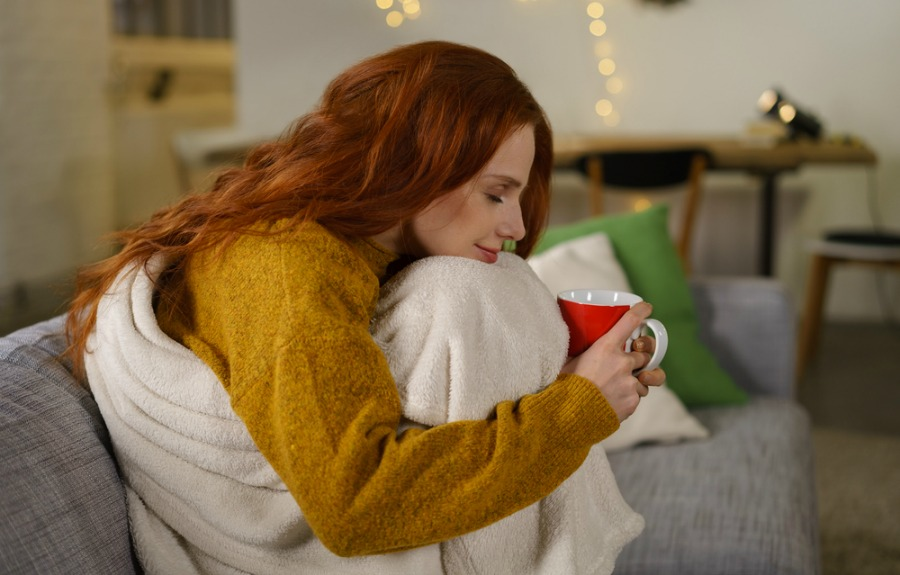 Redheaded Woman on the Cozy Couch
