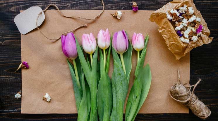 Flowers on a cutting board