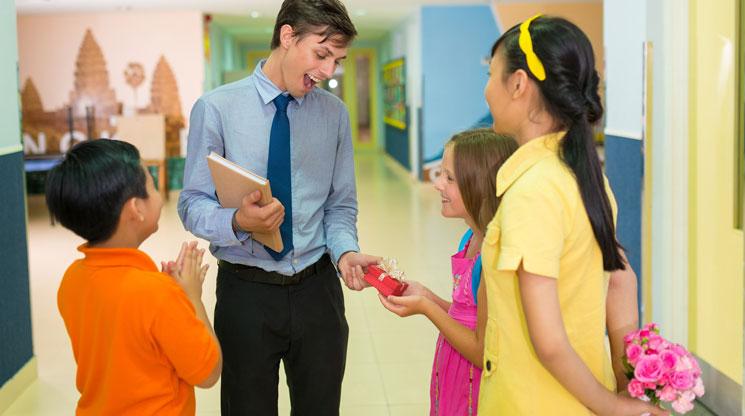 A teacher talking students